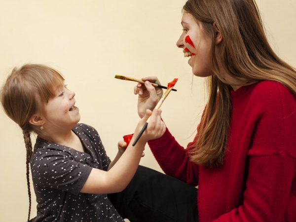 happy-woman-girl-with-down-syndrome-painting-each-other-s-faces